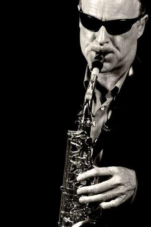 jazz saxophone player black and white Stock Photo