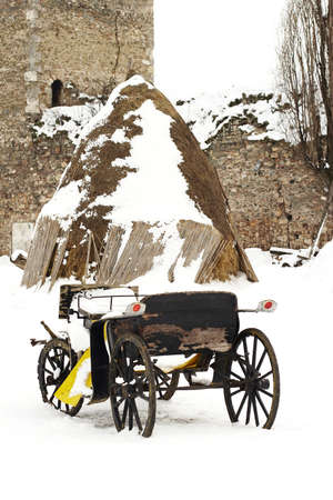 horse drawn carriage: an old horse drawn carriage in the snow Stock Photo