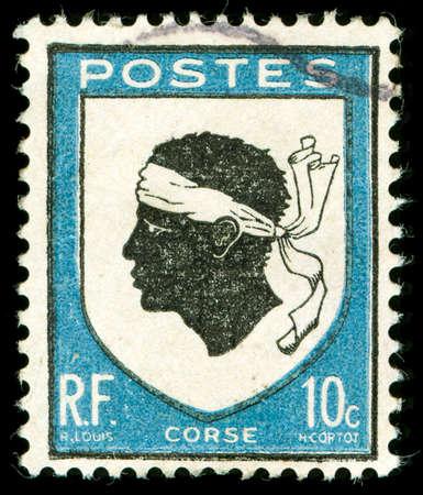 vintage postage stamp with corsica national emblem of a Moorish head Standard-Bild