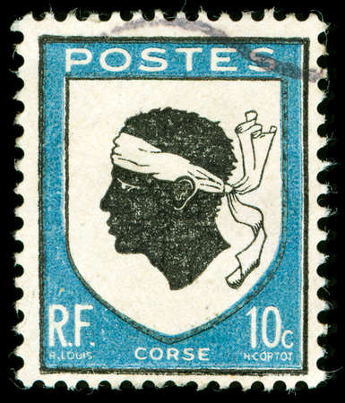 vintage postage stamp with corsica national emblem of a Moorish head Stock Photo
