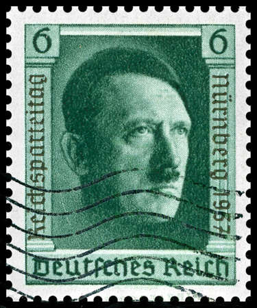 war crimes: 1937 vintage german postage stamp of Adolf Hitler Nuremberg was home of the Nazi rally of 1937 and the first war crimes trials after WW2 Editorial