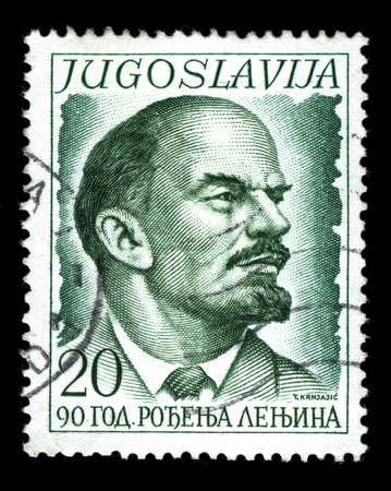 lenin: Vintage stamp depicting Vladimir Lenin one of the founding figures of the communist party of Russia and the Russian Revolution