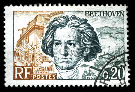 composer: vintage french stamp depicting Ludwig van Beethoven a famous classical music composer and virtuoso pianist Editorial