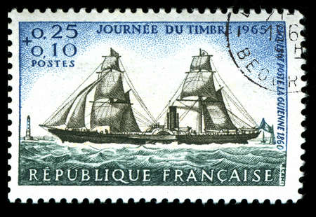 vintage French stamp depicting an old sailing ship delivering the mail photo