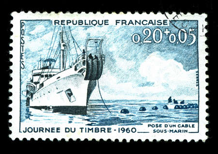 vintage french stamp depicting a cable laying ship  photo