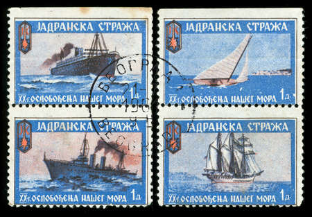 vintage stamp depicting ships from the former Yugoslavian Adriatic coastal Navy photo