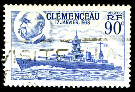 vintage french Stamp depicting the battleship Clemenceau launched 17th January 1939 photo