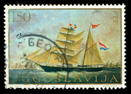 vintage stamp depicting a sailing ship under sail
