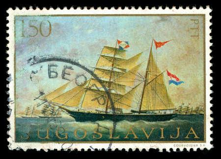 postmark: Vintage-Stempel zeigt ein Segelschiff unter Segel