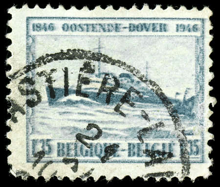 vintage french stamp, depicting an English channel passenger ferry on the route from Ostende to Dover 1946 photo