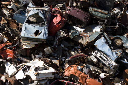 household accident: old rusting scrapped cars in a junk yard