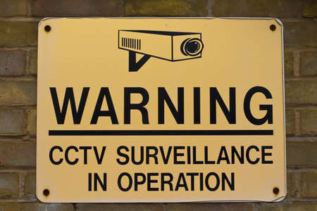 close circuit camera: yellow and black warning sign CCTV surveillance