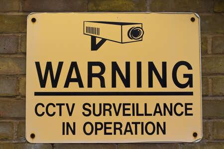 close circuit camera: yellow and black warning sign CCTV surveillance