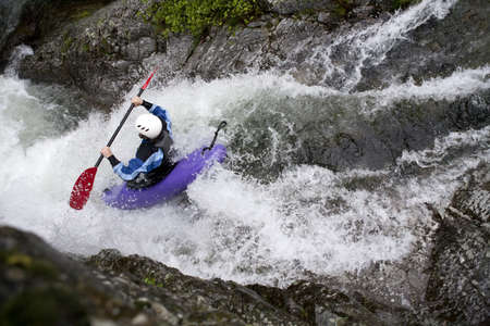 rapid: canoing on white water river