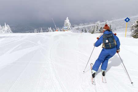 woman skiing on empty ski slope