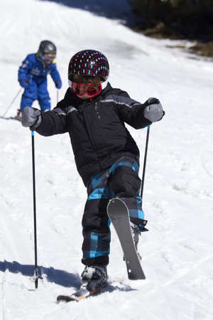 young boy learning to ski photo