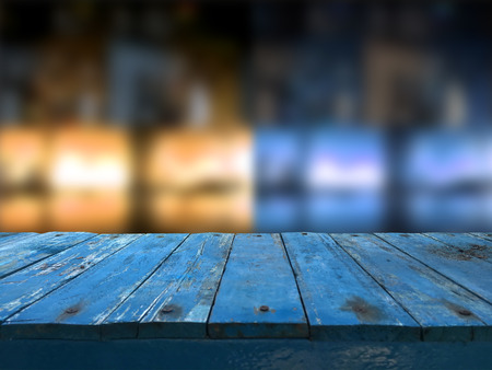 Empty dark blue wooden table in front of abstract blurred  blur background of restaurant. Can be used for display or montage your products.Mock up for space design.