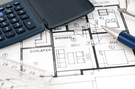 floorplan: Floorplan with calculator, ruler and pen Stock Photo