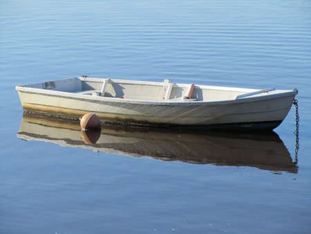 dingy: Little row boat on the water Stock Photo