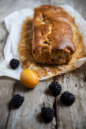 breackfast: plum cake with blackberries and plums Stock Photo