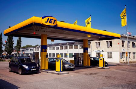 greenhouse effect: Use of fossil fuels for vehicles is a factor which influences the greenhouse effect. Swedish gas station associated gasoline brand JET at Bergaholmsv?n in S?t?e, Sweden, July 28, 2012.