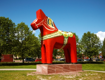 A wood sculpture of a dalecarlian horse (wooden horse), traditionally painted and decorated, located in the Swedish town Mora.  The dalecarlian horse is a symbol of the province of Dalarna in Sweden.  Mora, Sweden, 2012-06-07