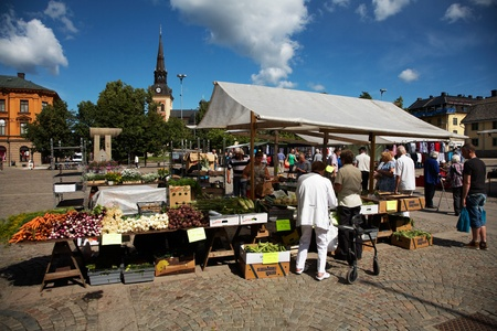 S?ERT?JE, SWEDEN - JULY 19, 2012: Main Square in S?t?e with the church in the background and vegetable sales in the foreground on the farmer Editorial