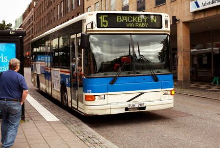 Vasteras, Sweden - September 16, 2012: Bus on line 15 in central V?er?leave the bus stop.  Stock Photo - 15246326