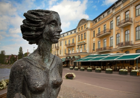 Karlstad, Sweden - September 11, 2012: Statue of waitress nicknamed Sola at Stadshotellet visible in the background. Stock Photo - 15337244