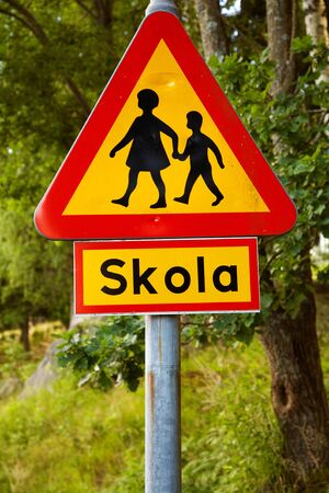 Swedish road sign warning for children, with the sign, which clarifies that there is a school nearby.