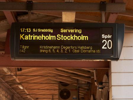 karlstad: rlstad, Sweden - October 4, 2012: Signage at Karlstad Central Station for departing trains to Stockholm via Katrineholm.  Editorial