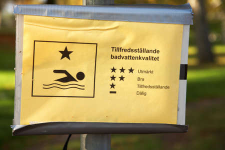 satisfying: Sign at Eklundsnas bathing in Sodertalje, Sweden describing it is a satisfying bathing water quality in the lake.