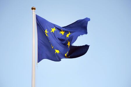 A torn flag of the European Union  The flag can symbolize decay and crisis    Stock Photo