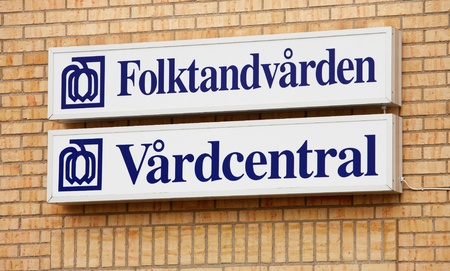 funded: The sign in the Swedish language for general medical center and dentist funded by the taxpayer which is run by the County Council of Uppsala, Sweden.   Editorial