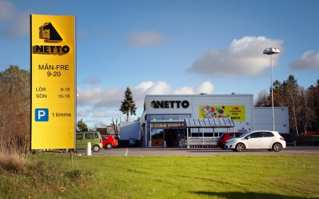 opening hours: Sodertalje, Sweden - October 27, 2012: Supermarket chain Netto at Klockarv?n, with a sign for opening hours.