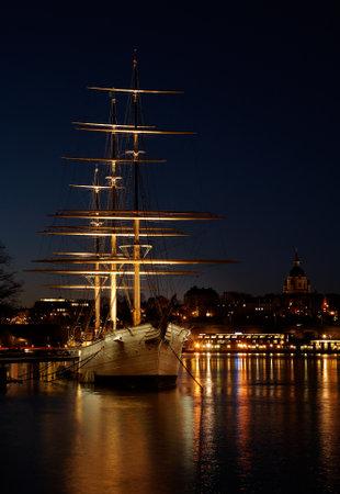 chapman: Stockholm, Sweden - November 9, 2012: Chapman sailing ship in the light of dawn at Skeppsholmen, now a youth hostel.
