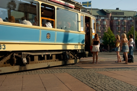 gothenburg: Gothenburg, Sweden: A vintage tram running on the ring line takes up the passenger at the stop