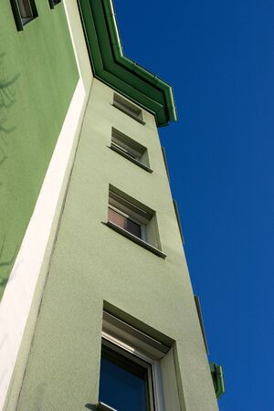 leases: The green facade striving upwards towards the blue sky