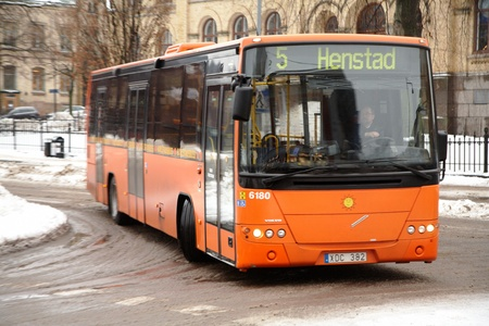 Karlstad, Sweden - December 16, 2012: Local bus on Line 5 with destination Henstad turns into Tingvalla street from Eastern Torggatan in Karlstad city center.   Stock Photo - 16870268