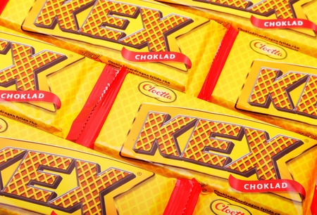 Several packages of Cloetta Kexchoklad, consisting of chocolate-coated wafers.
