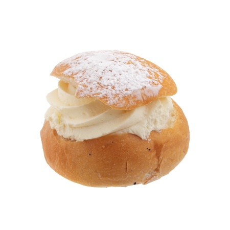 shrove: Semla, also called Shrove Bun, fettisdagsbulle consists of light wheat bread with almond paste and whipped cream filling  Serve it with hot milk called hetvägg  Isolated on white background