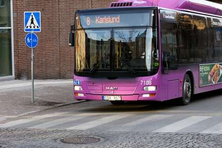 Orebro, Sweden - March 7, 2013: City bus on line 8 with destination Karlslund at the crosswalk Editorial