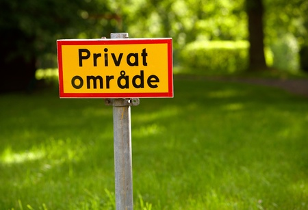 informs: Yellow sign with red frame and text in Swedish specify Private Area