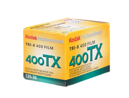An older film packaging from about 2002, with negative Kodak Tri-X B & W film ISO 400 for 36 exposures. Isolated on white background. Editorial