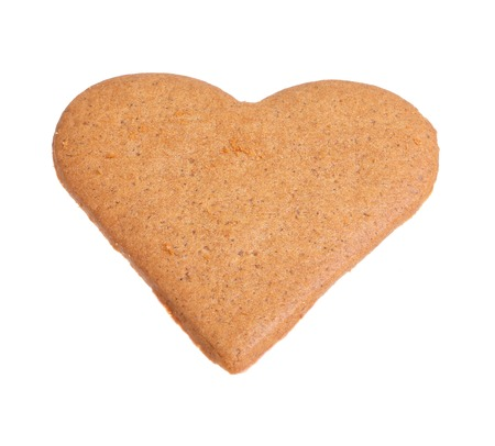 Gingerbread with the shape of a heart isolated on white background  photo