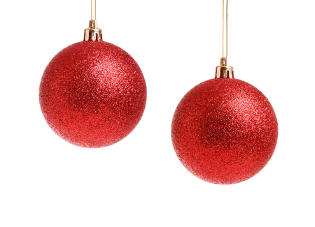 Two hanging red frosted Christmas balls isolated on white background