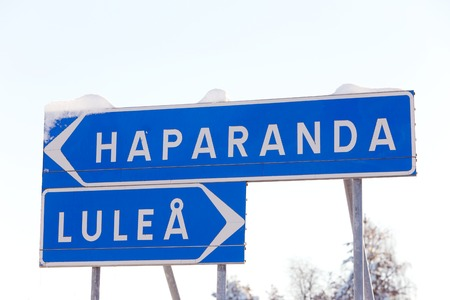 trailblazer: Signposts with snow leads the way to the Swedish cities of Lule� and Haparanda  Stock Photo