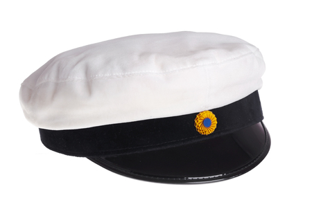 Swedish traditional graduation cap with yellow and blue rosette to be worn as a badge of completed studies at secondary school, isolated on white background