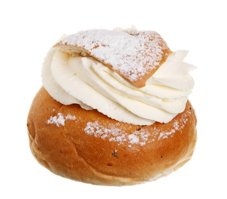 shrove: One Swedish Semla, also called Shrove Bun, fettisdagsbulle, consists of light wheat bread with almond paste and whipped cream filling  Serve it with hot milk called hetvägg  Isolated on white background