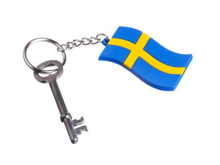 A key attached to a key ring with the Swedish flag isolated on white background